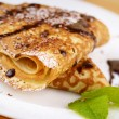 Crepes with chocolate sauce - Stock Photo