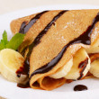 Crepes with chocolate sauce — Stock Photo #10151330