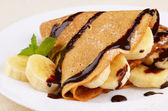 Crepes with chocolate sauce — Stock Photo