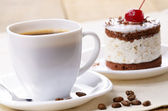 Cake and coffee cup — Stock Photo