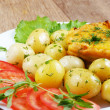 Fried fish with potatoes — Stock Photo