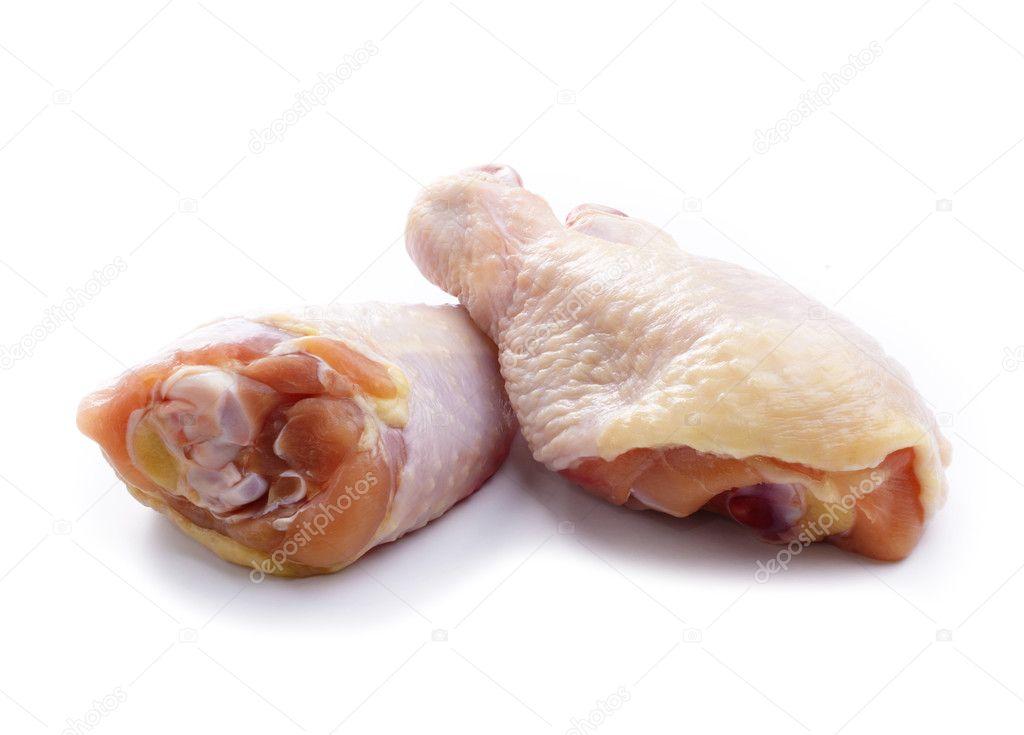 Raw chicken legs over white background  Stock Photo #10260173