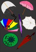 Illustrationa vector de varios paraguas — Vector de stock