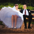 Bride and groom swing on a swing — Stock Photo