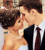 The bride and groom to kiss at the moment — Stock Photo