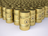 Rows of golden rusty oil barrels — Stock Photo