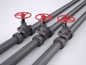 Three red oil valves — Stock Photo
