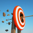 Arrow pierces target — Stock Photo #10677029
