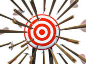 Many arrows flying towards the goal — Stock Photo