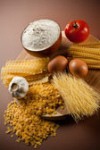 Variety of dried pasta and ingredients — Stock Photo