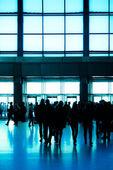 Crowd silhouette inside modern building — Stock Photo