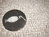 Sewer of fishing on the cobbled paving floor at Lisbon — Stock Photo