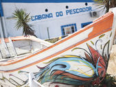 A painting boat placed at entrance beach — Stock Photo