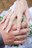 Hands of bride and groom — Stock Photo