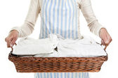 Woman holding a basket of clothes to iron, isolated — Stock Photo