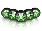5 black and green wheels — Stock Photo