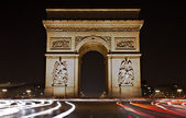 Illuminated Arc de Triomphe at night — Stock Photo
