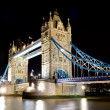 Illuminated tower bridge at night — Stock Photo