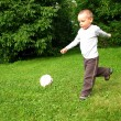 Little boy play football - Stock Photo