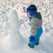 Little boy play on the snow - Stock Photo
