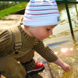 Little boy by the river — Stock Photo