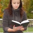 Young woman reading book — Stock Photo #10151381