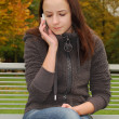 Young woman on the mobile phone — Stock Photo