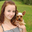 Young woman with dog — Stock Photo #10232884