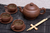 Ceramic teapot and cups — Stock Photo