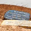 Stock Photo: Turtles nesting warning sign on beach