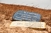 Turtles nesting warning sign on the beach — Stock Photo