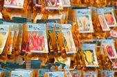 Tulip bulbs in bags on display — Stock Photo