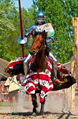 Medieval knights on horseback in combat — Stock Photo