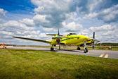 Small aircraft on runway — Stock Photo