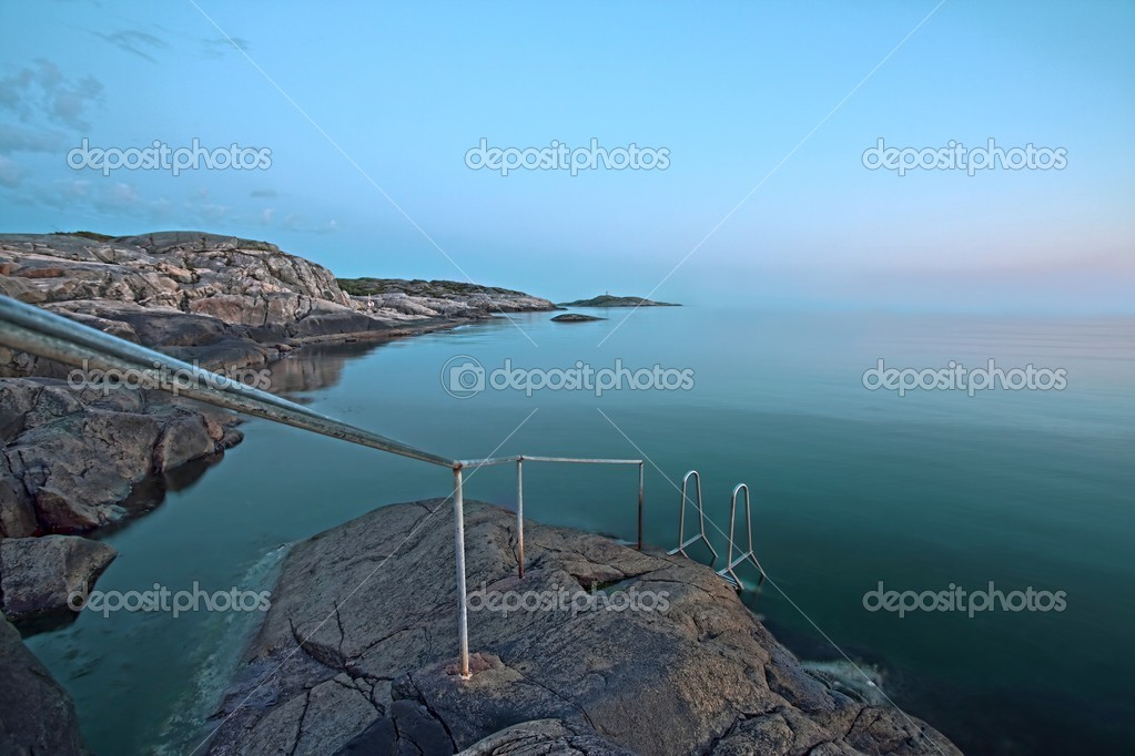 A railing leading down to the water — Stock Photo #10139613