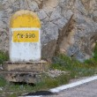Stock Photo: Milestone in the mountains