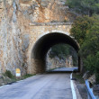 Stone tunnel at mountain road — Stock Photo #10102780