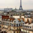 Постер, плакат: Eiffel tower over the roofs