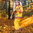 Pocahontas girl with bow in forest — Stock Photo #10063432