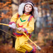 Pocahontas girl with a bow in the forest - Stock Photo
