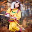 Pocahontas girl with bow in forest — Stock Photo #10064650