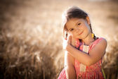 Child in the sun and grain — Stock Photo
