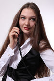 Business lady with a telephone — Stock Photo