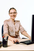 Smiling business lady in an office — Photo