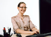 Smiling business lady in an office — Stock Photo