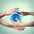 Royalty-Free Stock Photo: Hands round earth