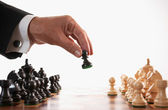 Businessman playing chess game selective focus — Stock Photo