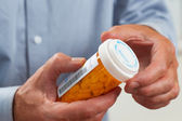 Close up of patient pouring out RX pills — Stock Photo
