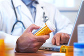 Doctor preparing online internet prescription — Stock Photo