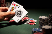 Blackjack hand of cards and casino chips — Stock Photo